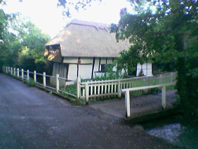 Picture of Old Kent Cottage from the northwest, showing the house overlooking Seabrook Stream.